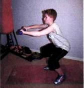 kid exercising squats