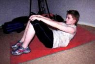 kid exercising sit-ups